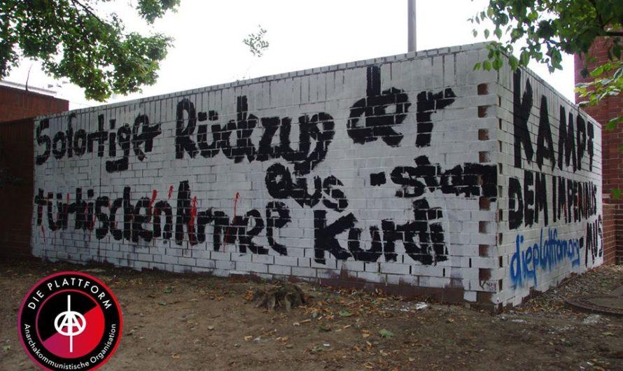 Wandbild gegen türkischen Imperialismus und Internationale Erklärung in Solidarität mit Rojava